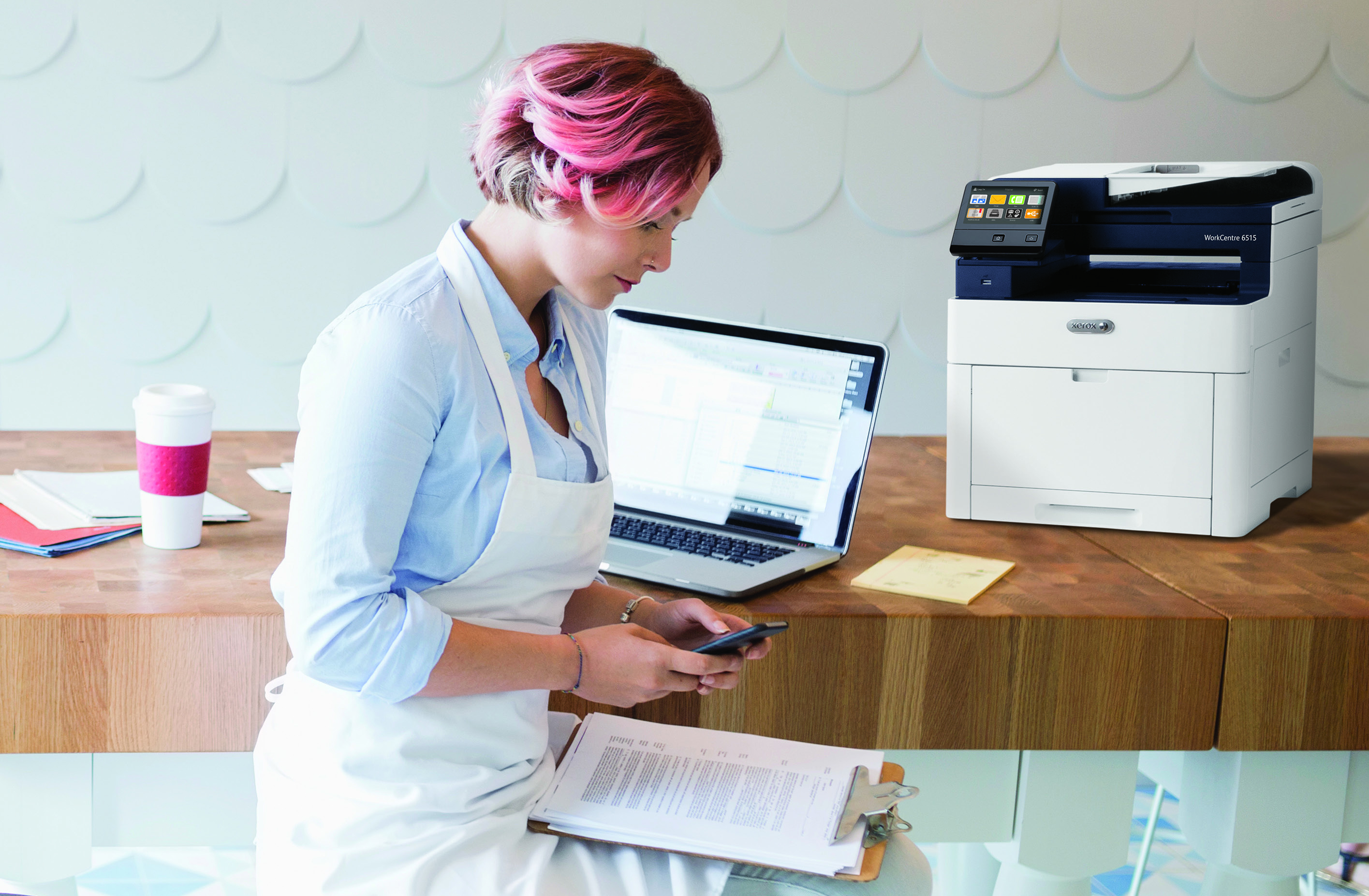 Employee working in an office with a Xerox Printer